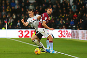 Derby County defender Craig Forsyth (3) and Aston Villa midfielder Conor Hourihane (14) during the EFL Sky Bet Championship match between Derby County and Aston Villa at the Pride Park, Derby, England on 10 November 2018.