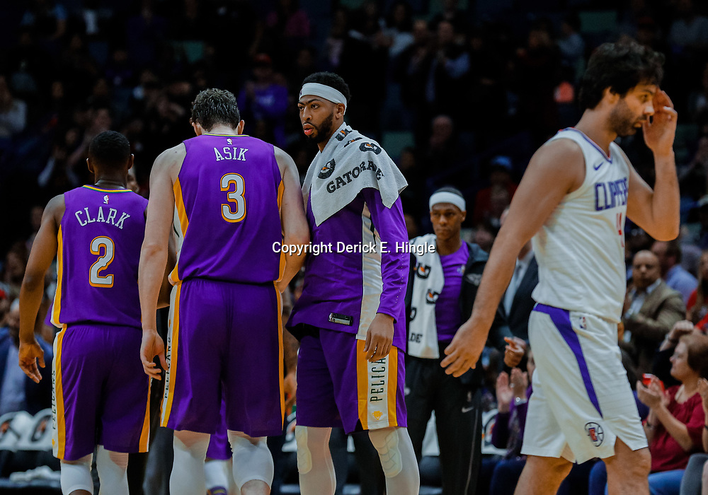 Jan 28, 2018; New Orleans, LA, USA; New Orleans Pelicans forward Anthony Davis (23) talks to teammates center Omer Asik (3) and guard Ian Clark (2) as LA Clippers guard Milos Teodosic (4) wallk off during a second quarter timeout at the Smoothie King Center. Mandatory Credit: Derick E. Hingle-USA TODAY Sports