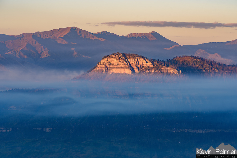 Smoke from the Hunter Peak wildfire was trapped under an inversion layer as the sun rose over the Beartooth Mountains.