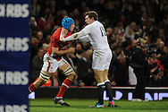 England's Alex Goode gets to grips with Justin Tupuric of Wales. RBS Six nations championship 2013, Wales v England at the Millennium stadium in Cardiff , South Wales on Saturday 16th March 2013. pic by Andrew Orchard, Andrew Orchard sports photography,