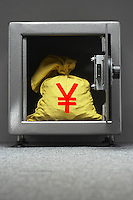 Bag of money with yen sign in open locker
