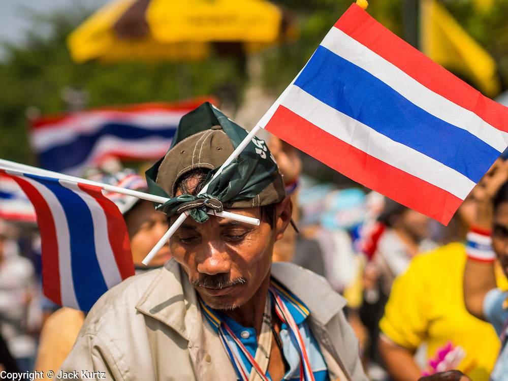 10 DECEMBER 2013 - BANGKOK, THAILAND:  Anti-government protestors dance in front of Government House. Protestors remained around Government House in Bangkok Tuesday but their mood was festive rather than angry. They listened to music and danced while protest leaders planned their next move.     PHOTO BY JACK KURTZ