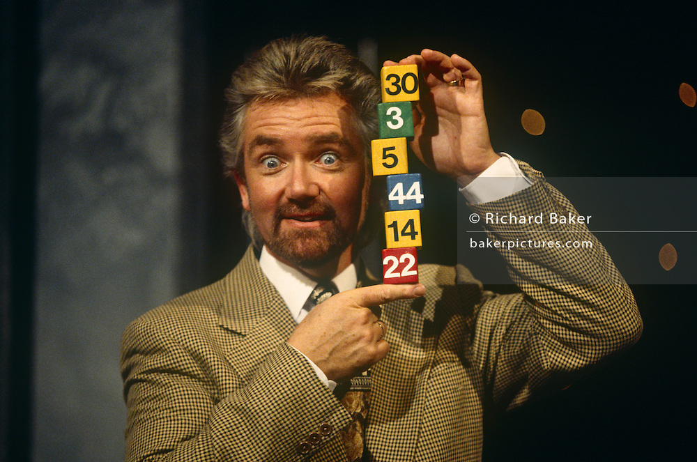 As first host of Britain's lotter on television, British TV personality, Noel Edmonds shows lottery numbers in 1994, at the BBC Television Centre studios.