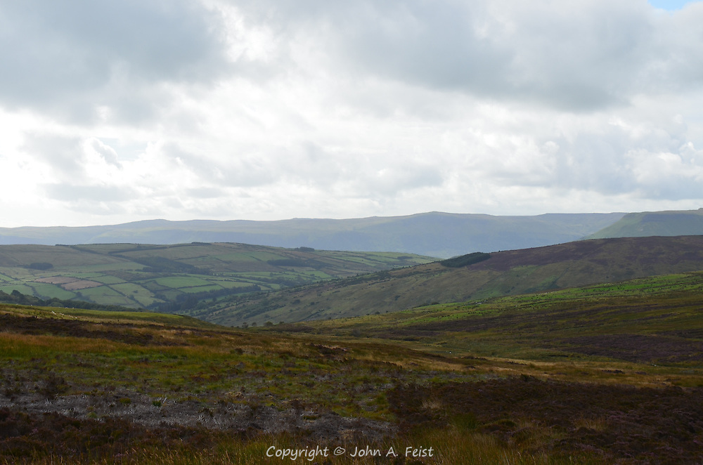 A long view of hills, fields and valleys in County Antrim, Northern Ireland