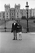 Couple in front of Windsor Castle, UK, 1980s.