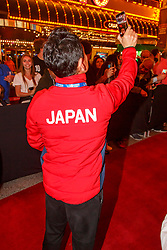 February 28, 2019 - U.S. - LAS VEGAS, NV - MARCH 01: A Japanese participant films the actions at the all nations parade the evening before the USA Rugby Sevens held March 1-3, 2019 at Sam Boyd Stadium in Las Vegas, NV. (Photo by Allan Hamilton/Icon Sportswire) (Credit Image: © Allan Hamilton/Icon SMI via ZUMA Press)