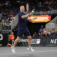 Tennis pro Jim Courier is seen on the court as he competes against John McEnroe during the PowerShares Tennis Series event at the Amway Center on January 5, 2017 in Orlando, Florida. (Alex Menendez via AP)