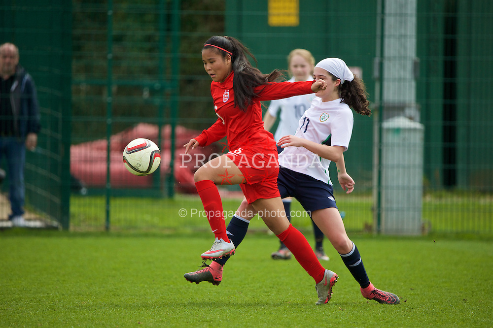 NEWPORT, WALES - Monday, April 4, 2016: England's Asmita Ale in action against Republic of Ireland's Amy Boyle Carr during the Final on day four of the Bob Docherty International Tournament 2016 at Dragon Park. (Pic by David Rawcliffe/Propaganda)