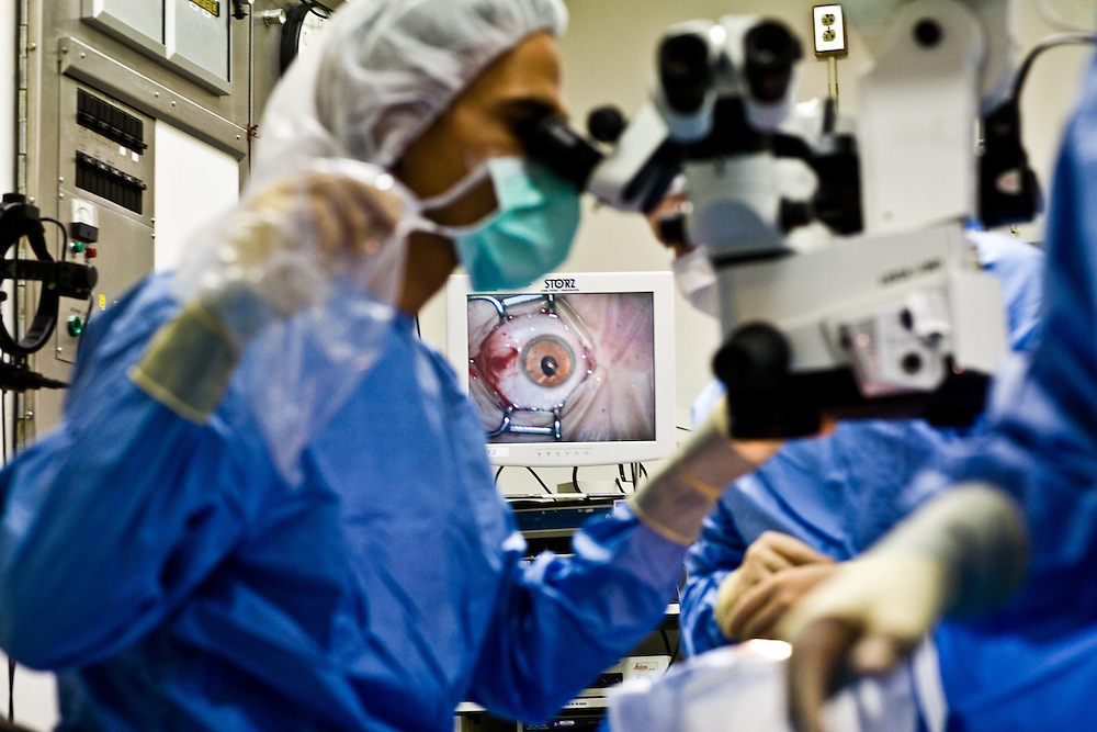 Dr. Albert Maguire begins the surgery on Corey Haas, 8, in an operating room at the UPenn Medical Center in Philadelphia, PA on Thursday, September 25, 2008.  A close-up of Corey's eye is seen in the monitor.