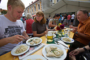 Kärntnernudelfest (Carinthian Dumplings Festival) in Oberdrauburg 2011. German tourists with their Kasnudeln.