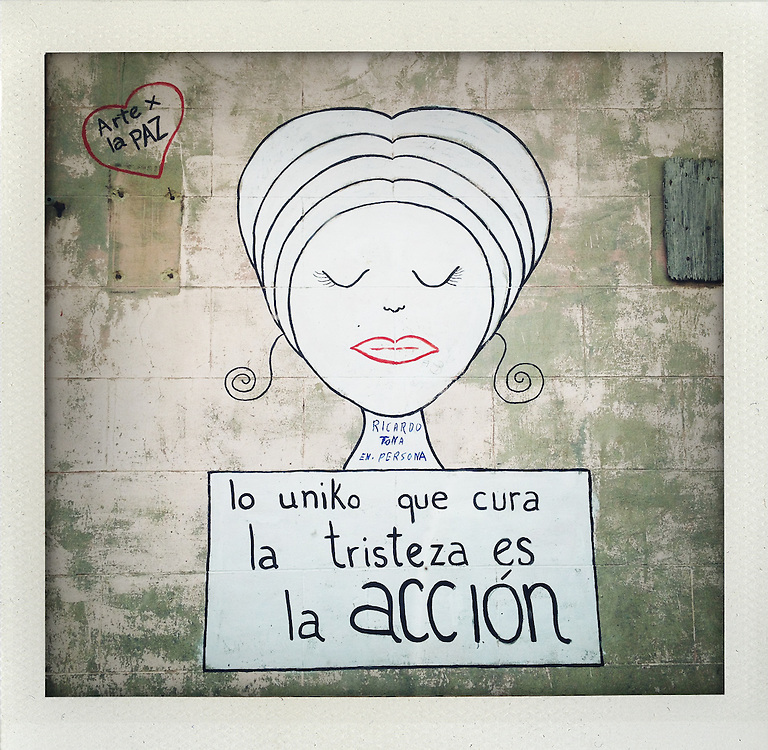"""The only thing that cures sadness is action"". .Mural in Matamoros, Mexico..My journey along the border from Brownsville and Matamoros to Juarez and El Paso..© Stefan Falke  www.stefanfalke.com.."