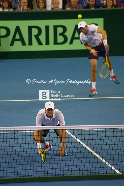 Bryan Borthers serve to Dominic Inglot and Jamie Murray during the Davis Cup Doubles in Glasgow