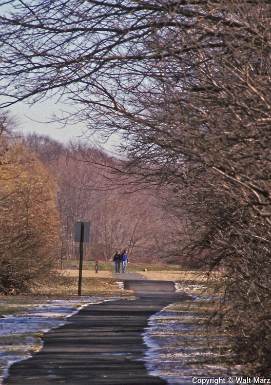 A couple walking their dog along the Lenepe Trail pathway, Plainsboro, NJ