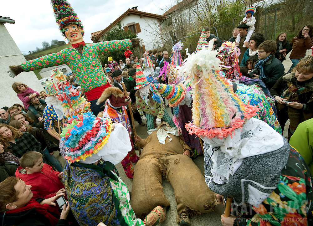 Ziripot (C) is helped by Txatxos surrounding him under the look of Miel Otxin (TopL) representing a thief during the ancient carnival of Lantz, in North of Navarra province in Spain, on March 8, 2011. PHOTO RAFA RIVAS