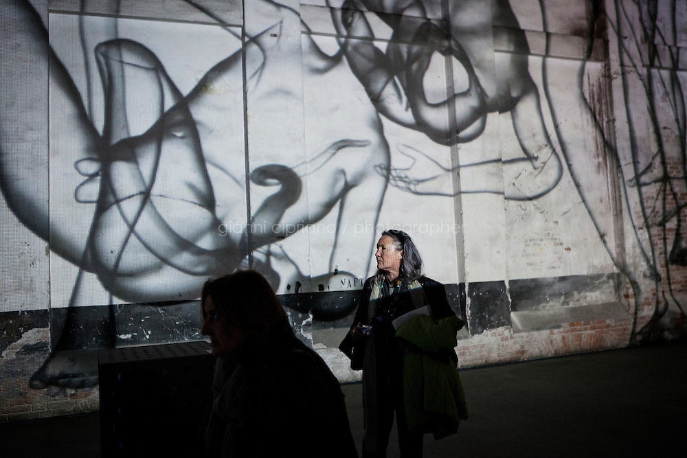 VENICE, ITALY - 29 MAY 2013: A visitor photographs Miao Xiachun's  3D compter animation projections at the Chinese Pavillon, at Arsenale in Venice, Italy, on May 29th 20113. <br /> <br /> &quot;Transfiguration is the thee of the Chinese Pavillon, oiuting to transformation in contemporary art and conceptualization, especially directed at the space of life and art crossing over, shifting from life to art, object to art work or artistic behavior, or non-art to art. Tranformation is one of the essential substances of contemporary art. &quot;Transfiguration&quot; in the Chinese Pavillon represents a geographical journey of Chinese contemporary art and the expression of its culture, moving from China to Europe, presenting in Renaissance Italy, together with all countries, a showcase of the contemporary world of diverse culture and thoughts.<br /> <br /> The 55th International Art Exhibition of the Venice Biennale takes place in Venice from June 1st to November 24th, 2013 at the Giardini and at the Arsenale as well as in various venues the city. <br /> <br /> Gianni Cipriano for The New York TImes