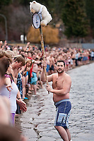 JEROME A. POLLOS/Press..Chad Bennett holds up the official Polar Bear Plunge clock to prepare people for the big plunge that took place at noon.