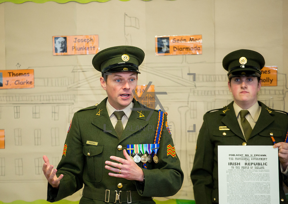 23/10/2015       <br /> Members of the Defence Forces were in Abbeyfeale today to present a handmade Tricolour and a copy of the Proclamation of the Irish Republic to students of the town's two primary schools.<br /> <br /> St Marys Boys National School and Scoil Mh&aacute;thair D&eacute; are among 3,000 schools nationally and 152 Limerick primary schools to receive the presentation as part of initiatives to mark the centenary of the 1916 Rising.&nbsp;<br /> <br /> Councillor Liam Galvin, Mayor of the City and County of Limerick joined pupils and teachers for today's presentation ceremony, which saw representatives of the Defences Forces raise the flag and read the Proclamation. <br /> <br /> Attending the ceremony at St. Marys Boys National School were, Sergeant James Reddan and Private Ciara Quinn. Picture: Alan Place.