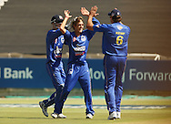Michael Rippon celebrates a wicket with Justin Kemp and Dane Vilas during the first leg of the semi-final in the Standard Bank Pro20 series between the Nashua Mobile Cape Cobras and the Nashua Titans played at Sahara Park Newlands in Cape Town, South Africa on 27 February 2011. Photo by Jacques Rossouw/SPORTZPICS
