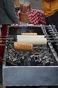 Romania, Transylvania a street vendor preparing Kurtoskalacs, (or Kurtos kalacs) a sweet pastry