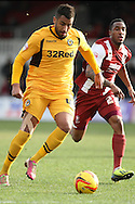 Rene Howe of Newport County and Craig Braham-Barrett of Cheltenham Town. Skybet football league 2 match, Newport county v Cheltenham Town at Rodney Parade in Newport, South Wales on Saturday 22nd Feb 2014.<br /> pic by Mark Hawkins, Andrew Orchard sports photography.