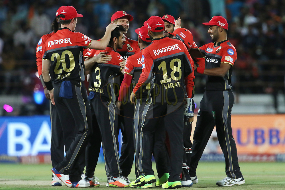 Royal Challengers Bangalore players celebrates the wicket of Gujarat Lions captain Suresh Raina during match 20 of the Vivo 2017 Indian Premier League between the Gujarat Lions and the Royal Challengers Bangalore  held at the Saurashtra Cricket Association Stadium in Rajkot, India on the 18th April 2017<br /> <br /> Photo by Vipin Pawar - Sportzpics - IPL