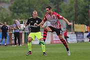 midfielder Luke Summerfield challenges midfielder Ryan Harley during the Sky Bet League 2 match between Exeter City and York City at St James' Park, Exeter, England on 22 August 2015. Photo by Simon Davies.