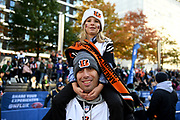 A Bengals fan with his young daughter on his shoulders during the International Series match between Los Angeles Rams and Cincinnati Bengals at Wembley Stadium, London, England on 27 October 2019.