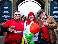 An England fan with two Wales fans<br /> <br /> Photographer Simon King/Replay Images<br /> <br /> Six Nations Round 3 - Wales v England - Saturday 23rd February 2019 - Principality Stadium - Cardiff<br /> <br /> World Copyright © Replay Images . All rights reserved. info@replayimages.co.uk - http://replayimages.co.uk