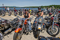 Enjoying a brilliant day and running into familiar faces on Lakeside Avenue Wednesday afternoon.  Susan and Len Greene of Troy, NY have been visiting Laconia for Bike Week for the past 27 years.   (Karen Bobotas/for the Laconia Daily Sun)