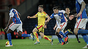 Lee Frecklington (captain) (Rotherham United) runs past Ben Mars (Blackburn Rovers) during the Sky Bet Championship match between Blackburn Rovers and Rotherham United at Ewood Park, Blackburn, England on 11 December 2015. Photo by Mark P Doherty.