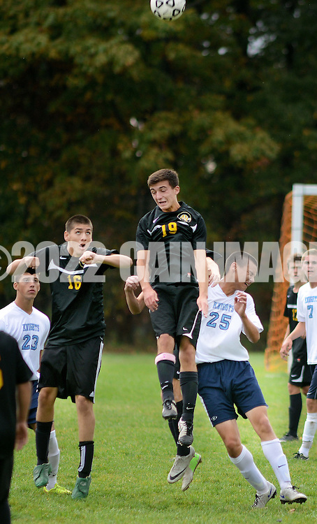TOWAMENCIN, PA - OCTOBER 7: Central Bucks West's  Nick Marella heads the ball while Central Bucks West's Marcos Urffer #16 backs him up, and North Penn's Owen Nakatani #25 defends in the first half at North Penn high school October 7, 2014 in Towamencin, Pennsylvania. (Photo by William Thomas Cain/Cain Images)