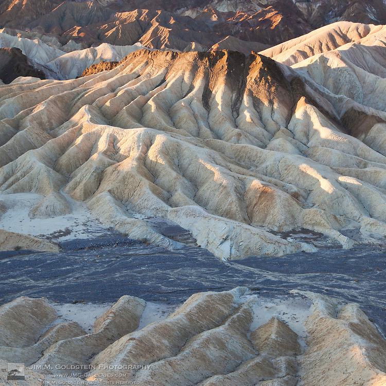 Sunrise on desert formations at Zabriskie Point in Death Valley National Park, California