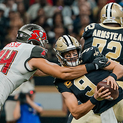 Sep 9, 2018; New Orleans, LA, USA; New Orleans Saints quarterback Drew Brees (9) escapes the grasp of Tampa Bay Buccaneers defensive end Carl Nassib (94) during the first half of a game at the Mercedes-Benz Superdome. Mandatory Credit: Derick E. Hingle-USA TODAY Sports