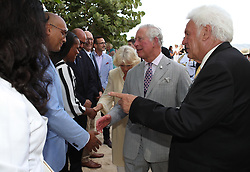 The Prince of Wales and the Duchess of Cornwall (centre) attend an exposition on the blue economy during a one day visit to the Caribbean island of Grenada.