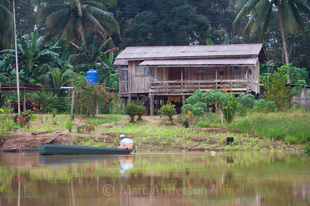 A wooden house on the banks of the Kinabatangan River, Sabah, Malaysia..