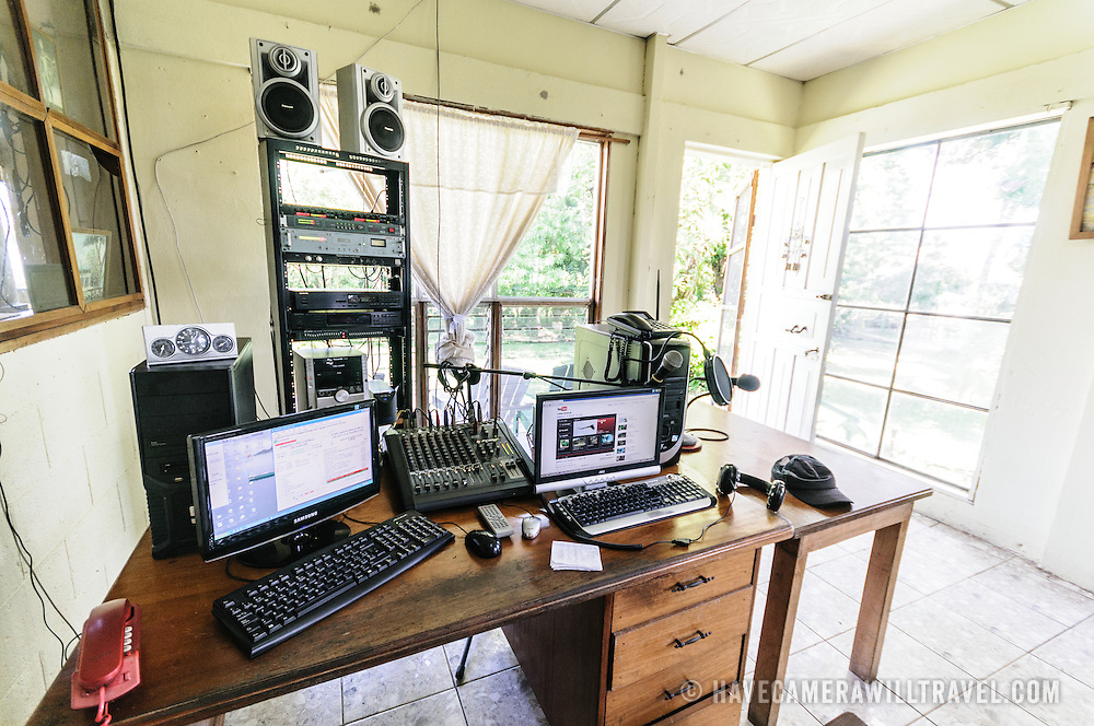 The studio of Radio Peten. Off the western side of the island of Flores is another much smaller island known simply as Radio Peten after the radio station that has broadcast from there since 1947. There are only a handful of buildings on the island, one of which is a small, one-room museum of Maya artifacts and various radio, telephone, and other artifacts. The only way to approach the island is by boat.