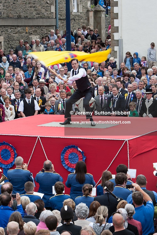 Robert Mailer Anderson, of San Francisco, is at the Colonial Standard Bearer, waving a yellow standard flag, during The Casting of the Colours ceremony, where the town's associations flags are waved in spectacular fashion in front of large crowds, in Selkirk, Scotland, Friday 14th June 2013.