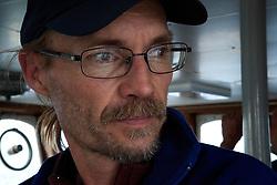 ATLANTIC OCEAN ABOARD ARCTIC SUNRISE 13MAY11 - Radio operator Stephen Hanner of the USA aboard the Arctic Sunrise...Photo by Jiri Rezac / Greenpeace