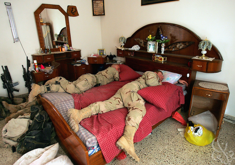 U.S. Army soldiers from the 1st Infantry Division's 2nd Battalion-2nd Regiment sleep in a captured Iraqi home November 10, 2004 during a break in fighting in the Iraqi insurgent stronghold of Fallujah.