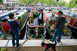 © Licensed to London News Pictures.30/04/2017.London, UK. Two narrowboat owners pose for a photograph as the  Canalway Cavalcade festival takes place in Little Venice, London on Saturday, 30 April 2017. Inland Waterways Association's annual gathering of canal boats brings around 130 decorated boats together in Little Venice's canals on May bank holiday weekend. Photo credit: Ben Cawthra/LNP