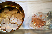 PRICE CHAMBERS / NEWS&amp;GUIDE<br /> Wafers and wine represent the body and blood of Christ for communion at the Chapel of the Sacred Heart.