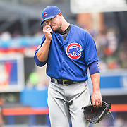 NEW YORK, NEW YORK - July 03: Pitcher Jon Lester #34 of the Chicago Cubs leaves the field after being pulled by Manager Joe Maddon #70 of the Chicago Cubs after giving up seven runs in the second innings during the Chicago Cubs Vs New York Mets regular season MLB game at Citi Field on July 03, 2016 in New York City. (Photo by Tim Clayton/Corbis via Getty Images)