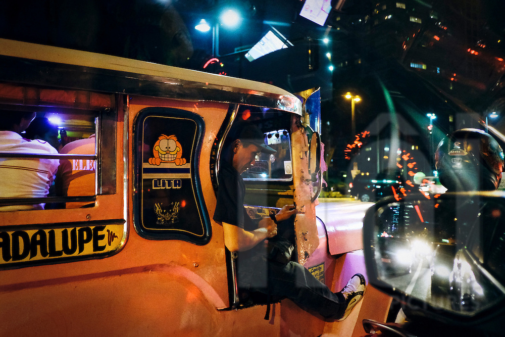 Jeepney at night in a street of Metro Manila, Philippines, Southeast Asia