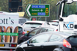 &copy; Licensed to London News Pictures. 18/04/2019.<br /> Dartford,UK. Local traffic near the Dartford Crossing. The Easter getaway traffic has started today with families setting out for a bank holiday weekend break. Very heavy traffic anti-clockwise causing miles of queues on the A282 Dartford crossing approach in Kent. Photo credit: Grant Falvey/LNP