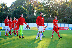BANGOR, WALES - Monday, October 15, 2018: Wales' captain Ryan Reynolds (R) and Poland's captain Jakub Kiwior (L) lead out the teams before the UEFA Under-19 International Friendly match between Wales and Poland at the VSM Bangor Stadium. (Pic by Paul Greenwood/Propaganda)