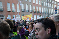 Protesters march in Dublin Ireland as part of a campaign organised by the Irish Congress of Trade Unions