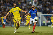 Portsmouth Defender, Brandon Haunstrup (38) beats AFC Wimbledon Forward, James Hanson (18) to the ball during the Carabao Cup match between Portsmouth and AFC Wimbledon at Fratton Park, Portsmouth, England on 14 August 2018.