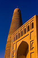 Uyghur mosque and Emin minaret, Turpan, Xinjiang Province, China. The minaret was built in 1777 is a 141 foot conical tower. Turpan is a small oasis town and former Silk Road outpost located in a depression 30m above sea level.