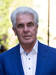 © Licensed to London News Pictures. 16/04/2014. London, UK. Publicist Max Clifford arrives at Southwark Crown Court in London on 16th April 2014. Clifford has pleaded not guilty to 11 counts of indecent assault relating to seven alleged victims aged from 14 to 20. Photo credit : Vickie Flores/LNP