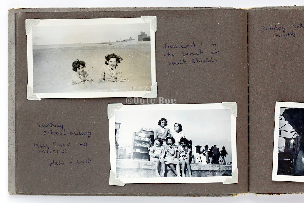family photo album page with beach scene England 1950s